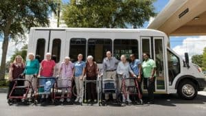Senior group outside of community bus before day trip